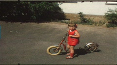 Children riding trike and bike in circles (vintage 8 mm amateur film) Stock Footage