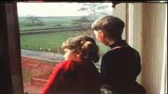 Children look out of window (vintage 8 mm amateur film) Stock Footage
