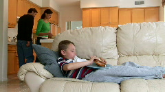 Child eating sandwich on couch Stock Footage
