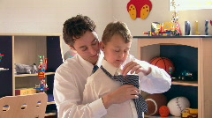 Stock Video Footage of Father helping his son with tie