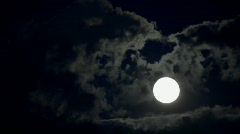 Timelapse with moon moving between clouds Stock Footage