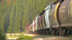 Railroad, freight train up heavy grade, sharp angle around bend Stock Footage