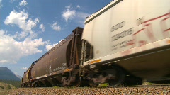 Railroad, freight train up heavy grade around bend, wide Stock Footage