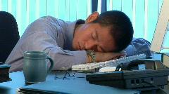 Sleeping Asian businessman awakened by phone call - stock footage
