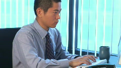 Stock Video Footage of Young Asian businessman typing on computer