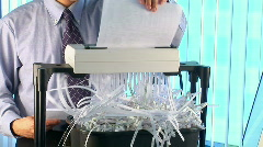 Businessman using paper shredder Stock Footage