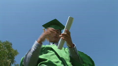 Young excited Asian man after graduation Stock Footage