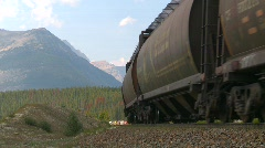 railroad, train up heavy grade in rocky mountains Stock Footage
