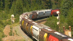 Railroad, freight cars around bend heavy grade Stock Footage