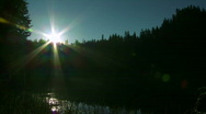Sunrise on the mountain lake time lapse Stock Footage