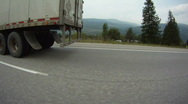POV fisheye shot, transport truck on highway drive along Stock Footage