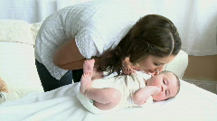 Bright young mother taking care of her baby Stock Footage