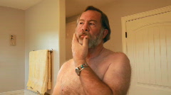 Man shave beard off fast P HD 0638 Stock Footage