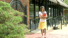 Pretty Girl Carries Books Stock Footage