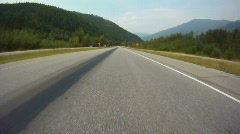 Time-lapse, drive on highway in mountain valley Stock Footage