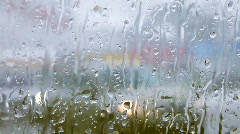 Snow and rain in cars traffic view from wet glass window 0-29 Stock Footage