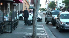 People man walking cars driving Downtown San Diego California - day Stock Footage