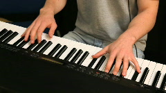 Young Male playing keyboard in classroom Stock Footage