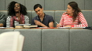 Students with teacher in lecuture theatre Stock Footage