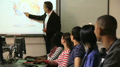 Students with teacher in classroom Stock Footage