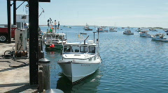 fishing boat pulls away from dock - stock footage