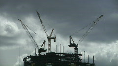 Billowing Clouds over Bow Tower Skyscraper Construction Cranes Stock Footage