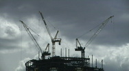 Stock Video Footage of Billowing Clouds over Bow Tower Skyscraper Construction Cranes