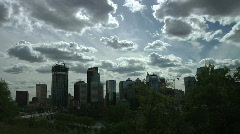 Billowing Clouds over Darkened Calgary City Skyline Stock Footage