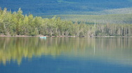 Canoe on mountain forest lake P HD 0166 Stock Footage