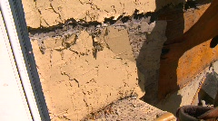 Home improvement, #29 removing slab of stucco from wall Stock Footage