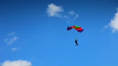 Flying on a parachute and alight on ground Stock Footage