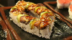 Sushi with avocado and eel - stock footage
