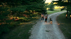 Mother and Son walking with dog Stock Footage