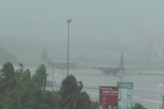 Hurricane Earl - C130 plan awaiting in runway under storm with audio Stock Footage