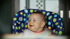 Baby boy at lunch time having fun, sound included Stock Footage