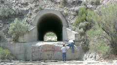 Two Guys Walk Through The Tunnel Under The Train Trax Stock Footage
