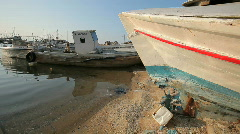 White boats in shallow sea shore water and on shore HD Stock Footage