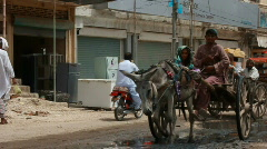 Donkey Carts & Rickshaws carrying Flood Refugees in Pakistan Stock Footage