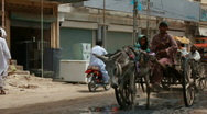 Stock Video Footage of Donkey Carts & Rickshaws carrying Flood Refugees in Pakistan
