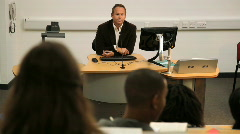 Teacher in front of students in lecture class speaking Stock Footage
