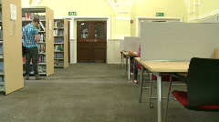 Students packing up and leaving library together Stock Footage