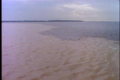 Amazon River, wedding of the waters with Rio Negro, two colors, wide shot Stock Footage