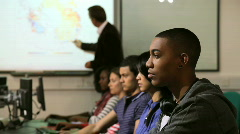 Students with teacher in computer classroom Stock Footage