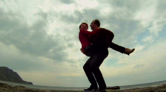 Guy keeps the girl in his arms Stock Footage