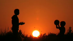 Children throw a ball, sunrise Stock Footage