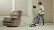 Man vacuuming carpet Stock Footage