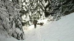 Hunter walking through snow Stock Footage
