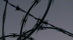 Concertina barbed razor wire border fence (HD) c Stock Footage