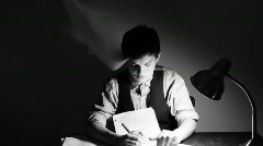 Young man overwhelmed by paperwork Stock Footage