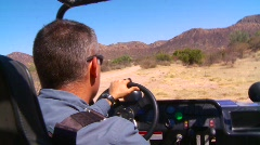 Mans Drives Dune Buggy Through Desert (HD) co Stock Footage
